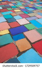 Colorful painted cement tile outdoor walkway. Suitable for background.s