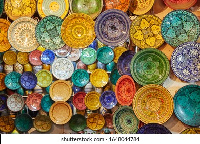 Colorful painted ceramic oriental plates - souvenirs in the market at Medina. Marakesh. Morocco. Oriental design, things for interior