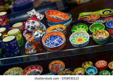 Colorful painted ceramics for sale on showcase of Istanbul bazaar. Traditional Turkish souvenirs