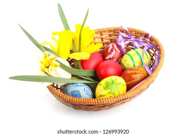 Colorful painted Easter eggs with flowers and ribbon in wooden basket
