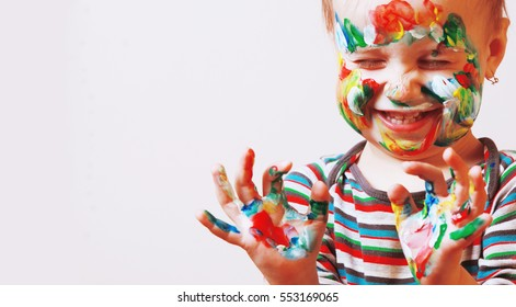 Colorful painted hands in a beautiful young girl
