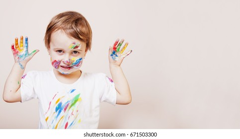 Colorful painted hands in a beautiful young girl (art, childhood, color concept)