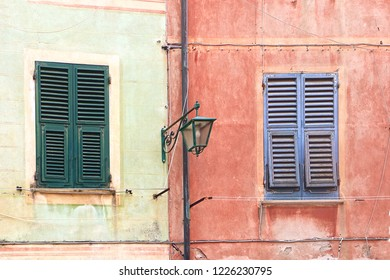 Colorful painted Ligurian houses in a typical fisher village on the sea