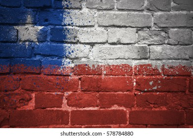 colorful painted national flag of chile on a old brick wall