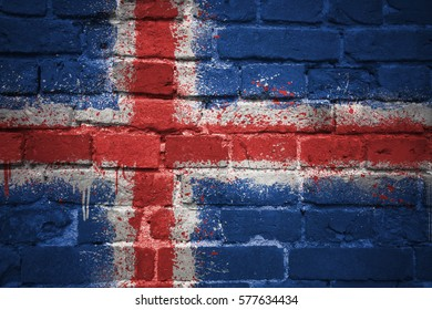 colorful painted national flag of iceland on a old brick wall
