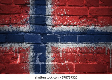 colorful painted national flag of norway on a old brick wall