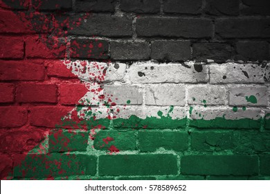 colorful painted national flag of palestine on a old brick wall