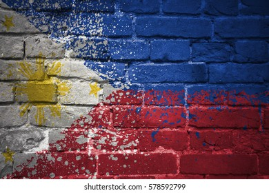 colorful painted national flag of philippines on a old brick wall