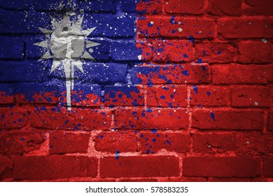 colorful painted national flag of taiwan on a old brick wall