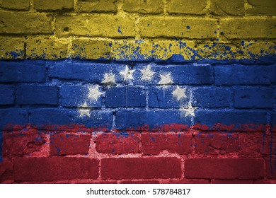 colorful painted national flag of venezuela on a old brick wall