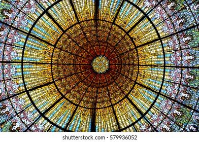The colorful painted stained glass ceiling of Palau de La Musica Orfeo Catala. Built in 1905-1908 by Lluis Domènech i Montaner. World Heritage Site by UNESCO in 1997. Barcelona, Spain. October 7, 2015