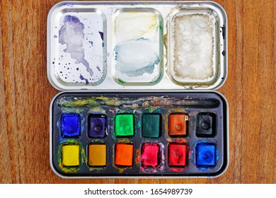 A colorful palette of watercolor artist paints