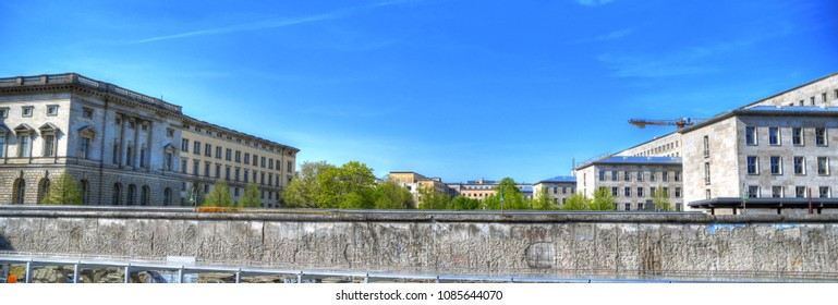 Colorful Panoramic image of the remnant of Berlin wall with the east side of Berlin on blue sky
