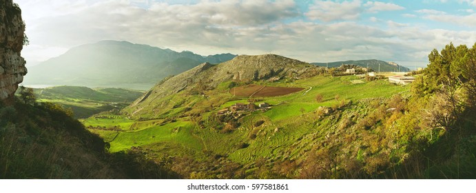 Colorful panoramic view on beautiful landscape of Sicily with a mountains, powerful clouds and green valley.