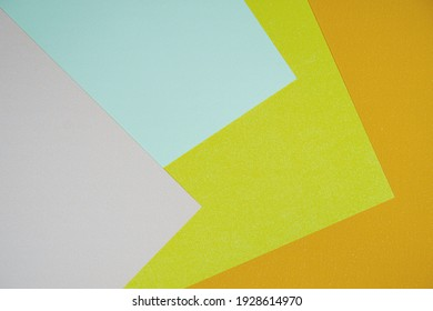 Colorful paper abstract background.(yellow,blue,orange,pink),Use as background.