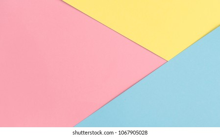 Colorful paper background piink blue yellow. Flat lay