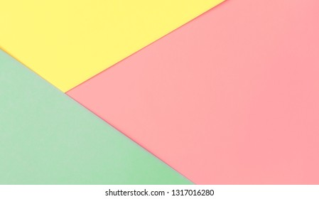 Colorful paper background pink yellow mint. Flat lay