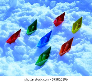 colorful paper boats in background like blue restless sea