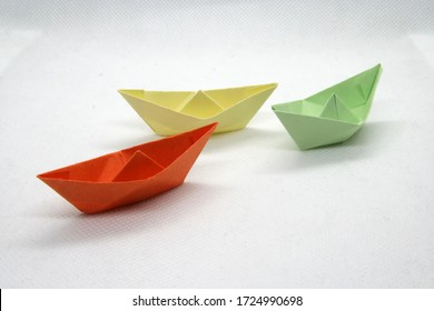 Colorful paper boats. Paper boats in various colors on a white background.