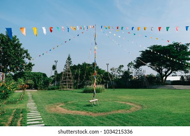 Colorful paper bunting party flags on blue sky