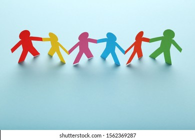 Colorful paper chain people on blue background