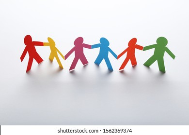 Colorful paper chain people on white background