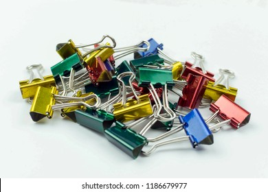 Colorful paper clip. Selection focus.