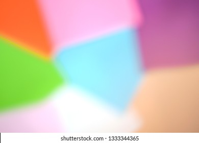 Colorful paper color orange, pink, purple, green, blue, white and light brown, rainbow concept. abstract blur background.