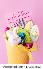 Colorful paper cone with cheerful easter treats and chocolates