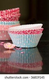 Colorful paper cupcake cases on a kitchen worktop