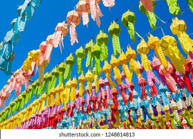 Colorful paper lanterns in traditional style of Northern in Thailand decorated in Buddhist temple