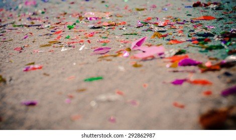 Colorful paper on the floor.