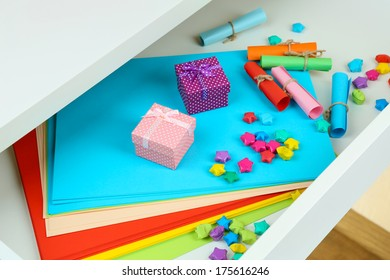 Colorful paper in open desk drawer close up