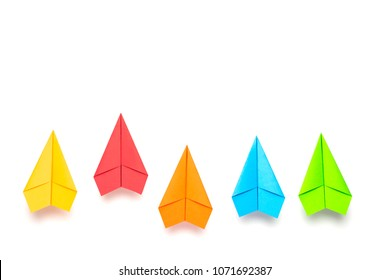 Colorful paper plane on white background, Business competition concept