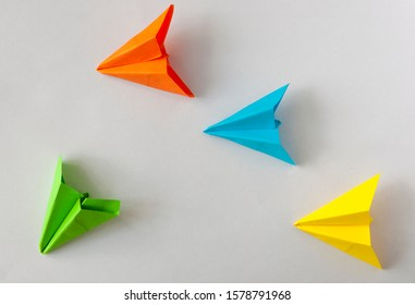 colorful paper plane on white background, Business competition concept.