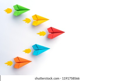 Colorful paper planes on white background. Business competition concept.
