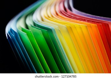 Colorful paper section in elliptical shapes on black background