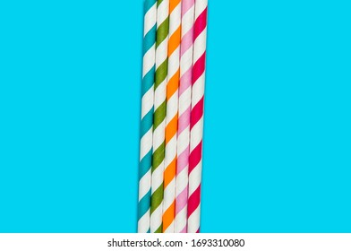 Colorful paper straws, blue background