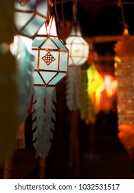 colorful paper, textiles bamboo lantern lamp lighting made of THAI traditional handmade craft vintage style for modern usage as street decoration around buddhism temple selective focus blur background