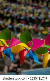 colorful paper windmills in a line