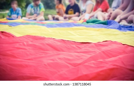 Colorful Parachute with Kids in Background Gym Class Outdoor Activity