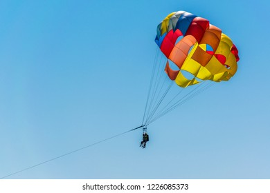 A colorful parachute on a blue sky background