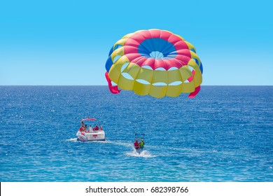 Colorful parasail wing pulled by a boat in the sea water - Alanya, Turkey