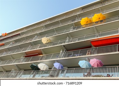 Colorful parasols on a balcony on the Delfland square in Amsterdam