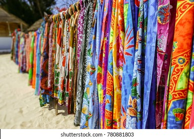 Colorful pareos for sale at the beach market