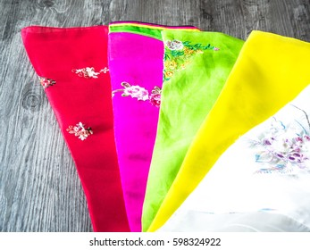 Colorful part of korean dress on wood grey background