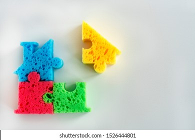 colorful parts on a light background. Creation and design  building. Concept component parts of something, Creating something. Concept The missing part. Completion of construction.