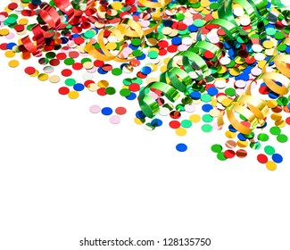 colorful party decoration with confetti and shiny streamer over white background