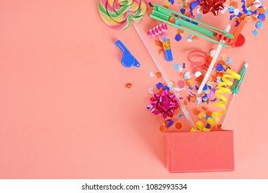 Colorful party frame with birthday objets on orange background. Celebration concept