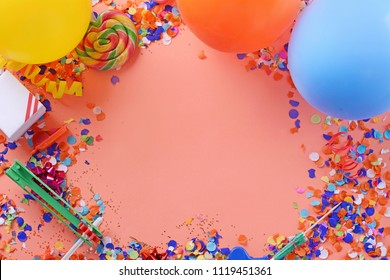 Colorful party frame with birthday objets on yellow background. Celebration concept